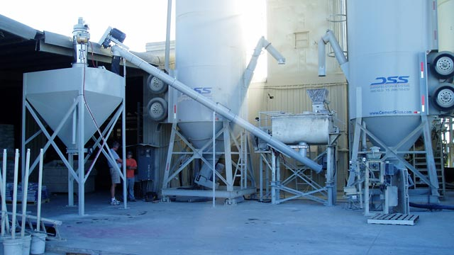 Two 60 ton scaled silos feeding feed 3000lb ribbon blender